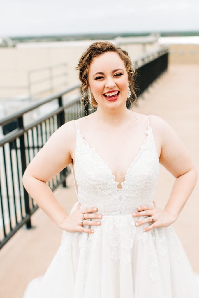 disney bride in Hayley Paige dress laughing on rooftop at California grill