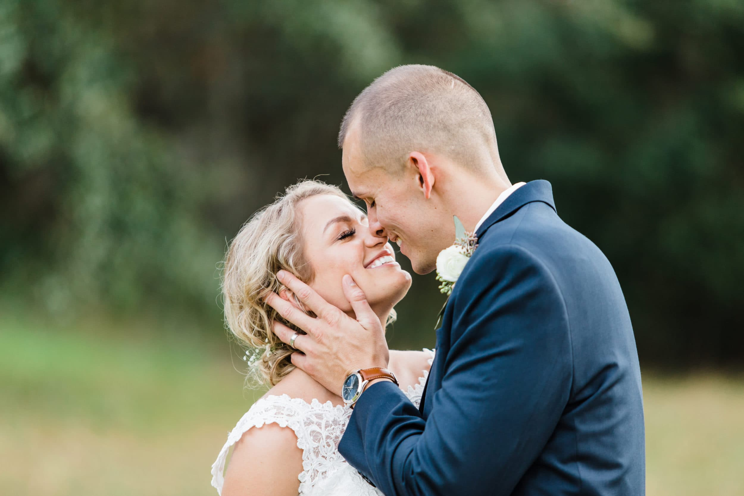 bride and groom smiling intimately while almost kissing at the bramble tree estate in mount dora florida