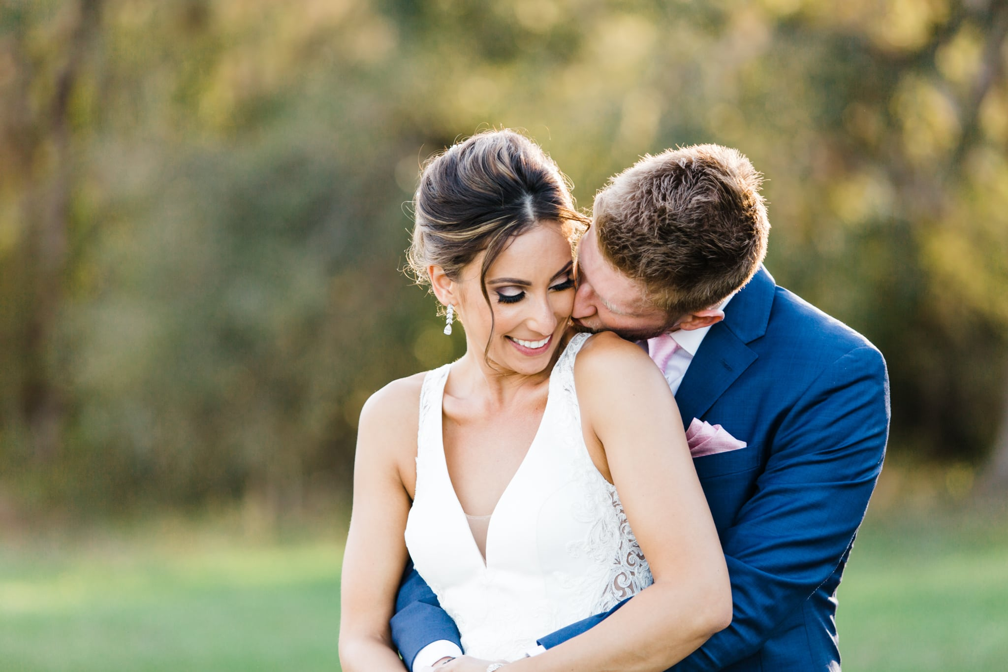 sun kissed bride and groom embracing each other during golden hour at October oaks farm in lake county florida