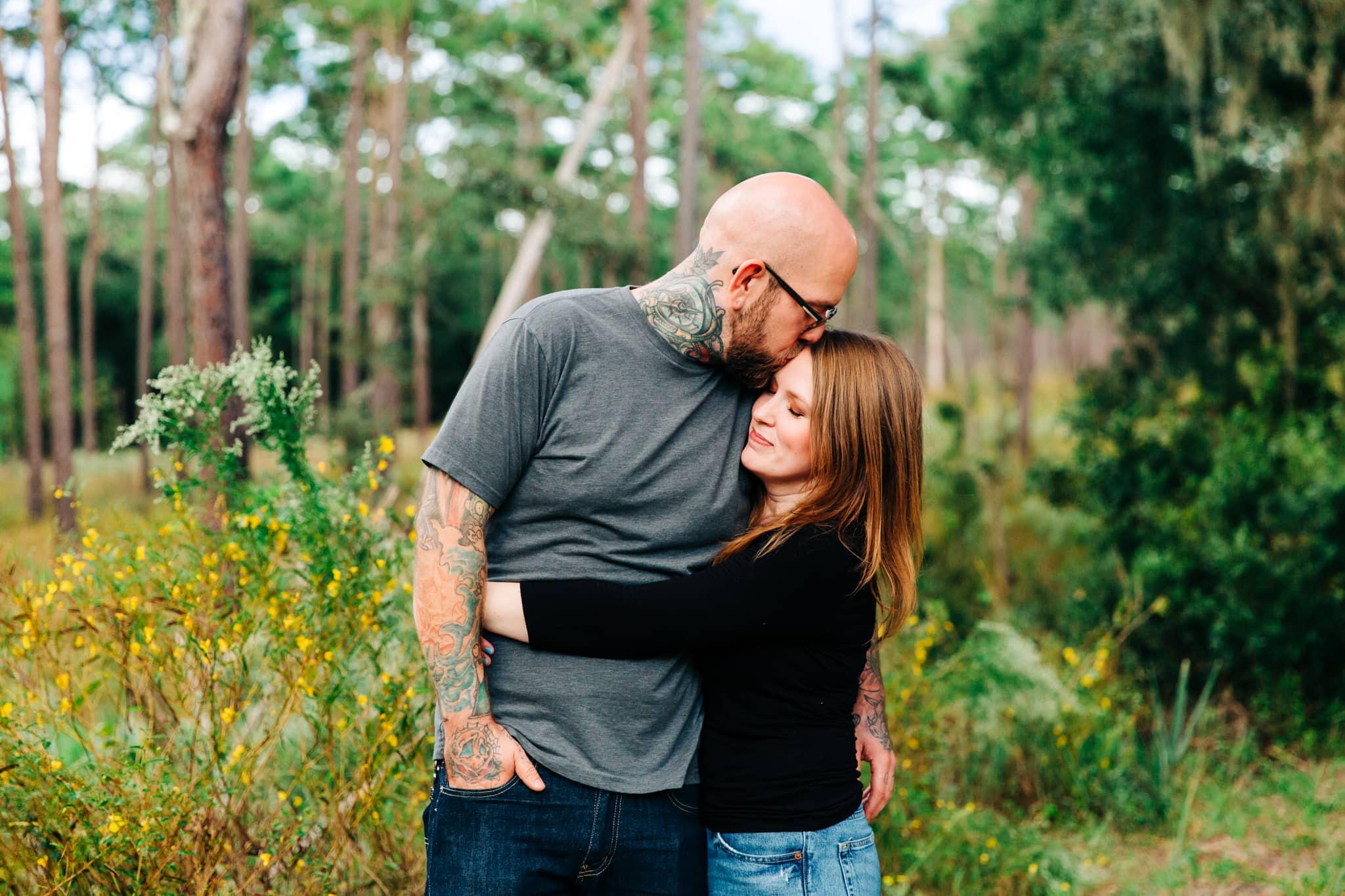 tattooed couple snuggling on wekiwa springs trail