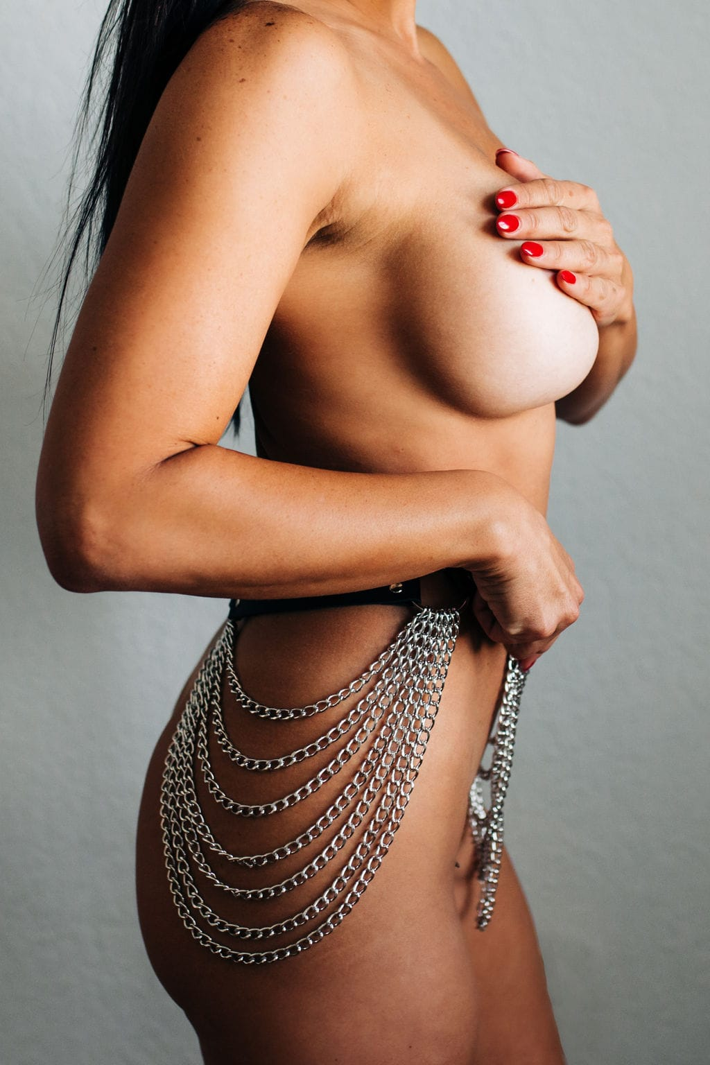 girl with body chain and red nails
